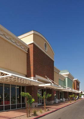 Row of new stores in outdoor mall.